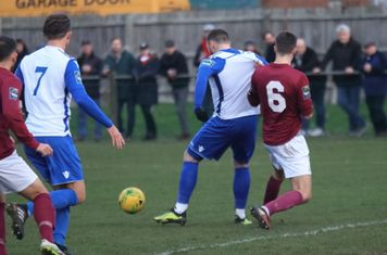 Potters Bar's Sean Grace (6) challenges Billy Bricknell