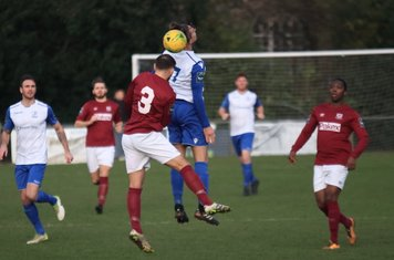Potters Bar's Andrew Lomas (3) challenges Sam Youngs