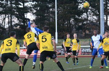 Billy Bricknell (white, L)) heads the opening goal