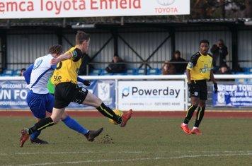 Margate's Connor Dymond (yellow) blocks Sam Youngs' shot