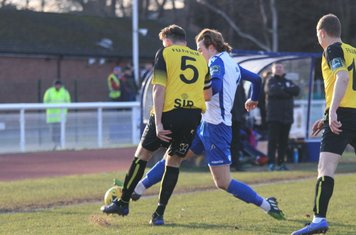 Enfield's Mickey Parcell (white) challenges Liam Friend (5)