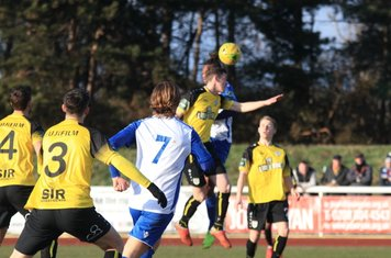 Margate's Connor Dymond (yellow, 2nd R) challenges Karl Oliyide
