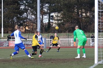 Margate's Ben Swift (yellow, L) clears the ball before it can reach Billy Bricknell (9)