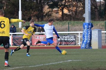 Enfield's Sam Youngs crosses from the left