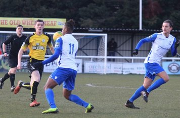 Enfield's Karl Oliyide (11) and Sam Youngs and Margate's Connor Dymond