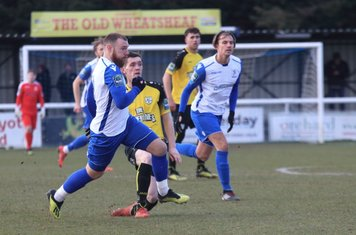 Enfield's Billy Bricknell (L) amd Sam Youngs and Margate's Connor Dymond