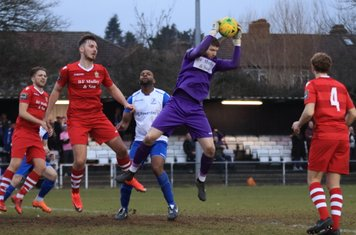 Hornchurch keeper Callum Chafer cuts out a cross to the obvious disappointment of Enfield's Kezie Ibe