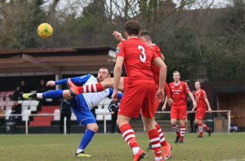 Enfield's Billy Bricknell (L) sees his shot blocked