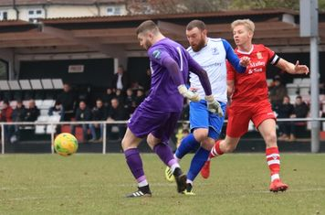Hornchurch keeper Callum Chafer clears from Billy Bricknell