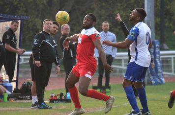 Leatherhead's Jerry Nnamani (red )and Enfield's Kezie Ibe