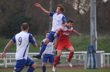 Enfield's Sam Youngs (white) challenges Craig McGee