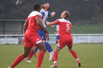 Enfield's Billy Bricknell and Leatherhead's Will Salmon (5) and Jerry Nnamani