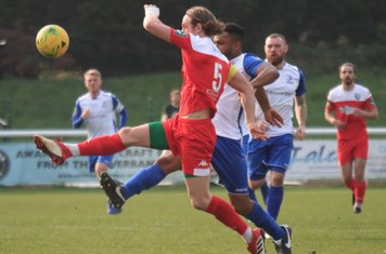 Leatherhead's Will Salmon (5) and Enfield's Kezie Ibe