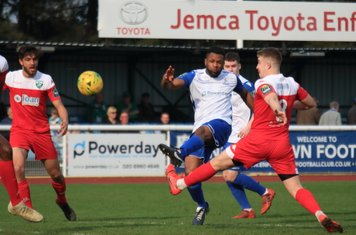 Enfield's Kezie Ibe shoots over the bar
