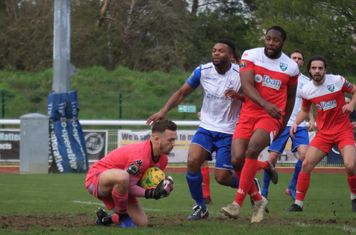 Leatherhead keeper Zaki Oualah saves ahead of Kezie Ibe (white) and Jerry Nnamani
