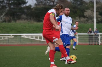 Leatherhead captain Will Salmon (red) clears from Billy Bricknell