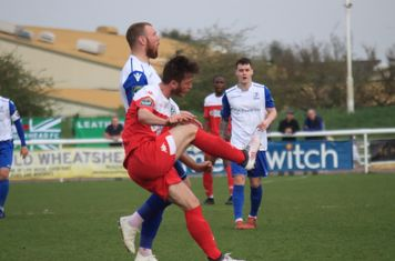 Leatherhead's Craig McGee (red) clears from Billy Bricknell