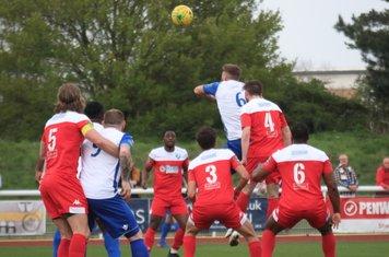 Enfield's Dan Rumens (white 6) heads on goal