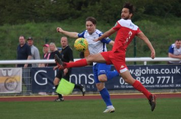 Enfield's Lewis Taaffe (L) shoots past the block of Misha Djmaili but wide of the post