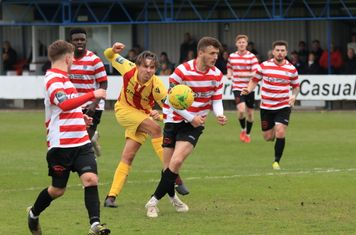 Kingstonian's James O'?Halloran (white boots) blocks Sam Youngs's shot