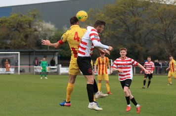 Enfield's Matt Johnson (yellow) challenges James O'Halloran