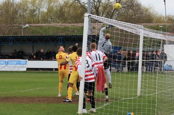 Kingstonian keeper Rob Tolfrey tips the ball over the bar