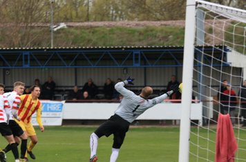 Kingstonian keeper Rob Tolfrey tips the ball round the post