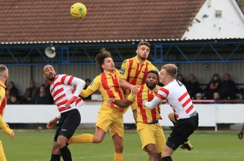 Enfield's Sam Youngs (yellow, L), Dan Rumens and Kezie Ibe and Kingstonian's Delano Sam-Yorke (L) and James Richmond