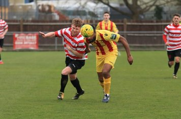 Enfield's Kezie Ibe (yellow) and Kingstonian's Tom Bird