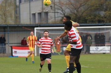 Kingstonian's Ismail Yakubu challenges Kezie Ibe (yellow)