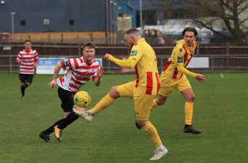 Enfield's Billy Bricknell and Sam Youngs (R) and Kingstonian's Tom Bird