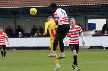 Kingstonian's Ismail Yakubu (5) wins a challenge against Billy Bricknell