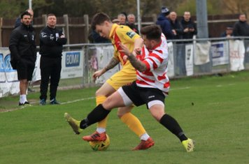 Enfield's Sam Chaney (yellow) and Kingstonian's Aaron Lamont