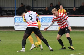 Enfield's Billy Bricknell i s closely marked by Ismail Yakubu (5) and James Richmond