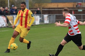 Enfield's James Mulley (L) and Kingstonian's Tom Bird