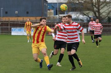 Enfield's Josh Davison and LKingstonian's James Richmond (R) and James O'Halloran