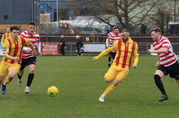 Enfield's Josh Davison (L) and Billy Bricknell and Kingstonian's James O'Halloran and Tom Bird (R)