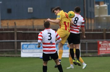 Enfield's Josh Davison and Kingstonian's James O'Halloran (3) and Aaron Lamont