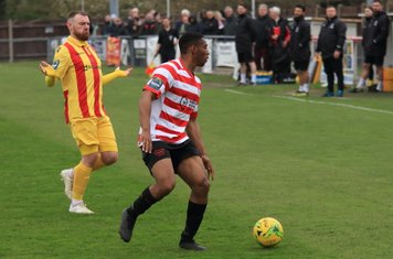 Enfield's Billy Bricknell (L) and Kingstonian's Jonathan Muleba