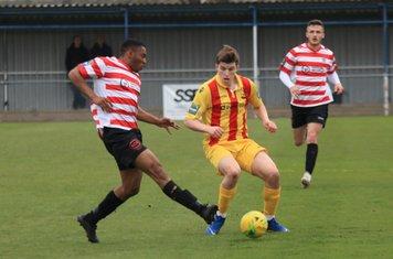 Kingstonian's Jonathan Muleba (L) and Enfield's Josh Davison