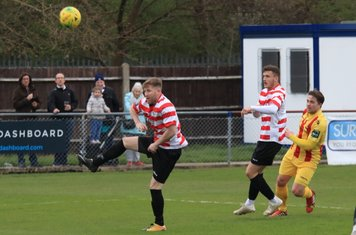 Enfield's Lewis Taaffe (R) shoots over the bar