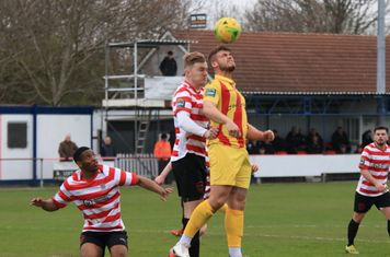 Enfield's Dan Rumens (yellow) challenges James Richmond