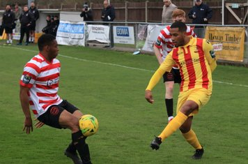 Kingstonian's Jonathan Muleba blocks James Mulley's cross