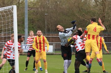 Kingstonian keeper Rob Tolfrey and defender Ismail Yakubu combine to block a header from Matt Johnson (4)