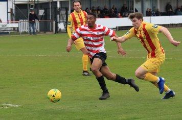 Enfield's Josh Davison (R) and Kingstonian's Jonathan Muleba