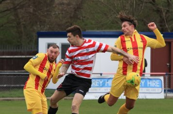 Enfield's Sam Youngs (R) and Billy Bricknell and Kingstonian's Dean Inman