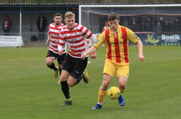 Enfields Josh Davison and Kingstonian's James Richmond (centre) and Aaron Lamont