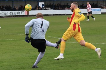 Kingstonian keeper Rob Tolfrey clears from Billy Bricknell