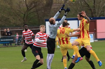 Kingstonian keeper Rob Tolfrey catches under pressure from Enfield's Josh Davison (10) and Matt Johnson
