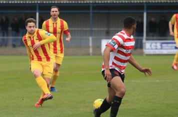 Enfield's Lewis Taaffe (L) and Matt Johnson and Kingstonian's Jonathan Muleba